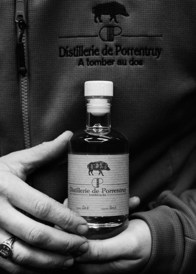 distillery porrentruy bottle hands boar